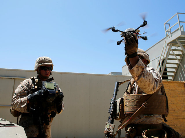 U.S. Marines deploy a Grp I UAS Instant Eye drone as part of a Rim of the Pacific (RIMPAC) 2016 exercise held at Camp Pendleton, California United States, July 13, 2016. (Photo by Mike Blake/Reuters)