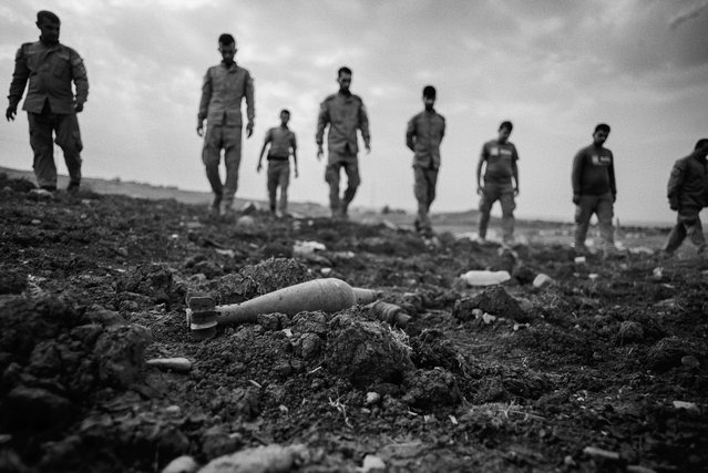 Mag technical staff conduct a visual search at Derabun, Dohuk in 2014. Up to this point they had found and removed 176 live unexploded ordnance and 386 unfused explosive items. (Photo by Sean Sutton for the Mines Advisory Group/The Guardian)