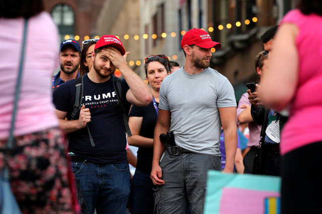 """Trump supporters, including one carrying a handgun, listen to  """"Code Pink"""" protesters outside of the Republican National Convention in Cleveland, Ohio, U.S., July 18, 2016. (Photo by Lucas Jackson/Reuters)"""