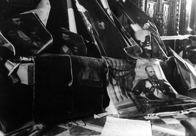 Portraits of the Tsars of Russia, Alexander III, right, Alexander II, above centre, and Nicholas II, left, which were torn from the walls during the Russian Revolution, 1917. (Photo by Three Lions)