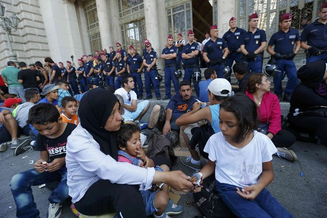 Hungarian police officers block the entrance of the Keleti train station for refugees in Budapest, Hungary September 2, 2015. (Photo by Laszlo Balogh/Reuters)