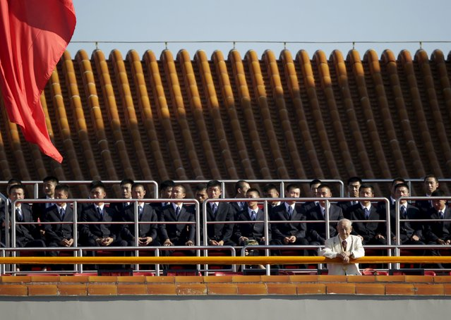 Security officers sit on the Tiananmen Gate, ahead of the military parade to mark the 70th anniversary of the end of World War Two, in Beijing, China, September 3, 2015. (Photo by Jason Lee/Reuters)