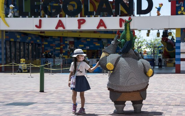 A girl wearing a face mask looks at a Lego display at the Legoland Japan theme park on May 23, 2020 in Nagoya, Japan. The theme park located in central Japan reopened today. As Covid-19 coronavirus cases continue to abate, the Japanese government announced on May 21 that the state of emergency will be lifted in all areas of the country except for Tokyo and the prefectures of Chiba, Kanagawa and Saitama as well as Hokkaido. (Photo by Tomohiro Ohsumi/Getty Images)