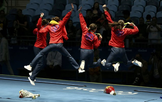 2016 Rio Olympics, Fencing, Victory Ceremony, Women's Epee Team Victory Ceremony, Carioca Arena 3,  Rio de Janeiro, Brazil on August 11, 2016. Romania celebrates winning the gold medal. (Photo by Issei Kato/Reuters)