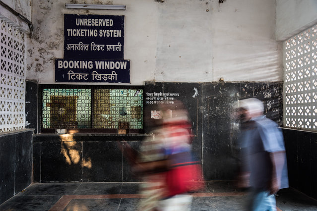 A deserted ticket booking counter in New Delhi, India, October 2017. Constructed in 1975 to bypass the crowded and passenger-heavy Old Delhi, New Delhi and Hazrat Nizamuddin railway stations, the railway line once used to be the lifeline of the capital. Over the past two decades, however, the rail network has been lying in neglect as the geographical make-up of the city changed drastically – leading to a massive drop in the number of passengers. Compared to it's much modern and younger cousin, Delhi Metro, it saw an average daily ridership of just 3,700 passengers. The 35.36km stretch connects 21 stations, including 12 halts and nine block stations but deserted locations, badly maintained platforms, encroachments, poor safety measures and lack of last-mile connectivity are keeping the passengers away. In February 2016, all the services were withdrawn and now there's just one train plying on the line. The stations have a ghostly look about them even in rush hour except for few 4-5 people waiting for the local, to take them to their offices. Hardly anyone rode these trains and the mood within is quite monotonous and stale. From observation it could also be said that the life in the local trains of the capital of India is mundane. People are generally seen dozing off or keeping to themselves. (Photo by Ankur Dutta/Barcroft Media)