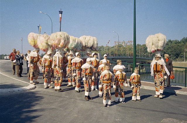 The Gilles, a colorful dance troupe from Mons, Belgium dance their way through the new bridge at Saint James, East of Paris, September 18, 1971 as they took part in the inauguration ceremonies. (Photo by Jean-Jacques Levy/AP Photo)