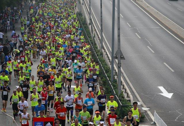 Participants run during the Beijing International Marathon in Beijing, China, September 20, 2015. (Photo by Kim Kyung-Hoon/Reuters)