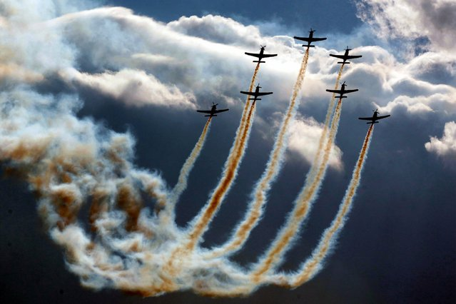 A group of seven planes from the Polish Air Force team perform a formation flight during the 3rd Annual Athens Flying Week 2014 at Tatoi airport. Athens, Greece, September 28, 2014. (Photo by Pantelis Saitas/EPA)