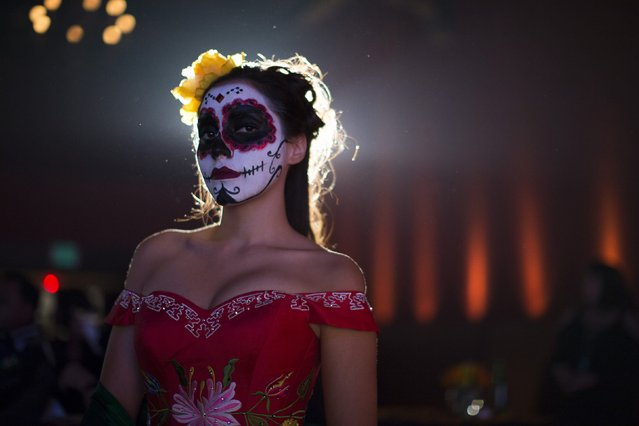 A model is pictured during a Quinceanera Magazine Catrina fashion show at a press reception ahead of the 15th annual Dia de los Muertos, or Day of the Dead, festival at Hollywood Forever Cemetery in Los Angeles, California October 24, 2014. (Photo by Mario Anzuoni/Reuters)