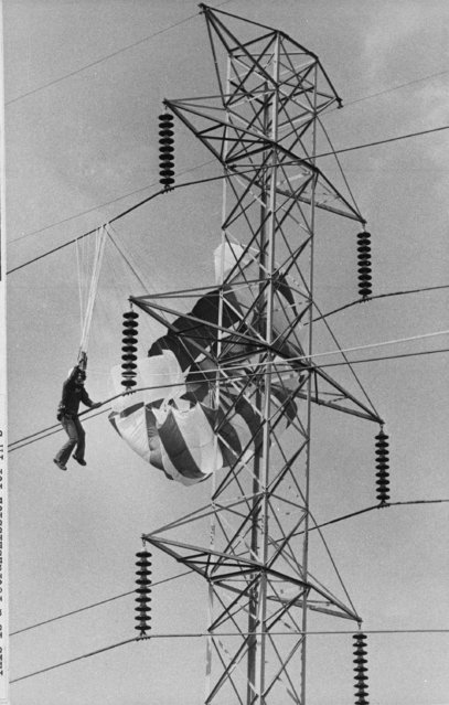 In this October 8, 1978 file photo, 17-year-old Danny Matthews of Irving, Texas is suspended about 60 feet in the air with his parasail caught in a power line. Danny was parasailing, pulled by a truck, when a strong crosswind forced him into the electrical cables. (Photo by Mark Graham/AP Photo)