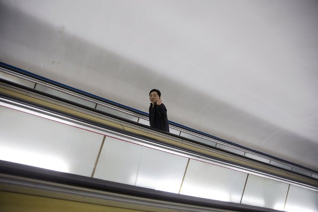 A man gestures as foreign reporters enter a subway station during a government organised tour in Pyongyang, North Korea, October 9, 2015. (Photo by Damir Sagolj/Reuters)