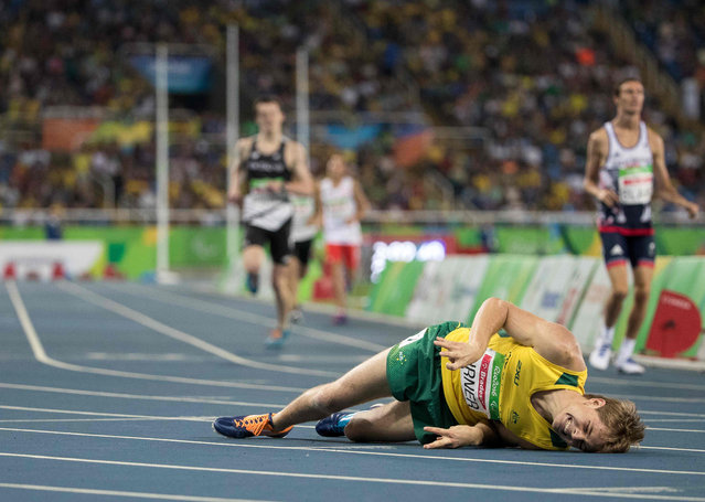 James Turner of Australia collapses after winning the Men's 800m – T36 Final with the World record of 2:02.39 during the Athletics competition at the Olympic Stadium during the he Paralympic Games, Rio de Janeiro, Brazil, Saturday 17th September 2016. (Photo by Al Tielemans/OIS/IOC)