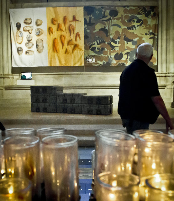 """Artist Tattfoo Tan's installation """"Nemre"""", appearing among the works of 30 artists in the multimedia exhibition """"The Value of Food: Sustaining a Green Planet"""" at the Cathedral of St. John the Divine, Wednesday, October 7, 2015, in New York.  (Photo by Bebeto Matthews/AP Photo)"""