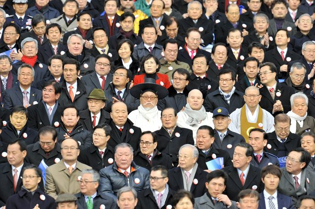 A South Korean elderly man (C) wearing a traditional scholar outfit sits during the presidential inauguration ceremony for South Korea's incoming president Park Geun-Hye at the National Assembly in Seoul on February 25, 2013. Park Geun-Hye was sworn in as South Korea's first female president on February 25, vowing zero tolerance with provocations from a nuclearised North Korea and a new era of economic prosperity for all. (Photo by Jung Yeon-Je/AFP Photo)