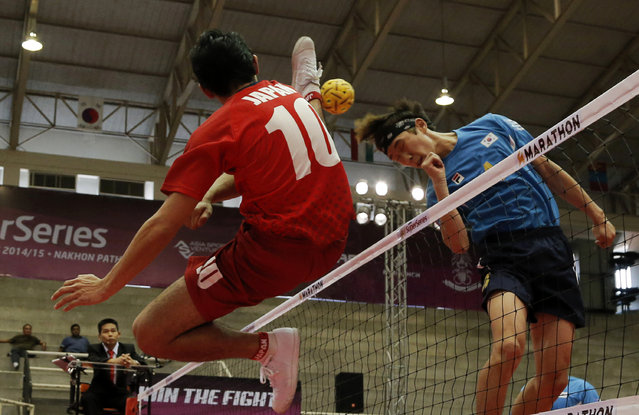 Sepak Takraw, ISTAF Super Series Finals Thailand 2014/2015, Nakhon Pathom Municipal Gymnasium, Huyjorake Maung, Nakonprathom, Thailand on October 21, 2015: Japan's Toshitaka Naito (L) and South Korea's Lee Seungwoo in action during their group stage match. (Photo by Asia Sports Ventures/Action Images via Reuters)