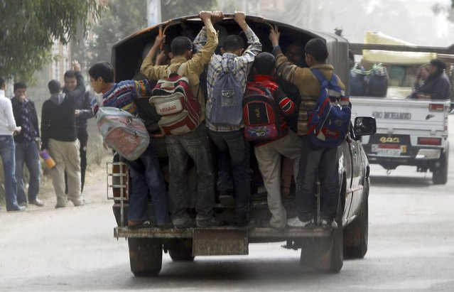 Students travel in a vehicle after attending school at Ibsheway el-Malaq village in Gharbia governorate, about 165 km (103 miles) northeast of Cairo, March 12, 2012. (Photo by Amr Abdallah Dalsh/Reuters)
