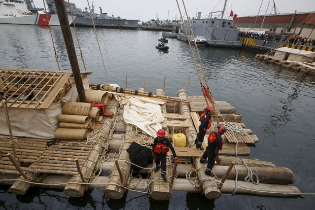 One of the two wooden rafts of the Kon-Tiki II expedition is prepared  at the port of Callao prior to the departure to Pascua island in Chile, in Callao, Peru, October 30, 2015. (Photo by Mariana Bazo/Reuters)