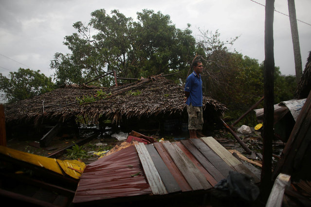 Fisherman Eneides Soares, 41, stands next to his destroyed house after the passage of Hurricane Matthew in Carbonera, Cuba, October 5, 2016. (Photo by Alexandre Meneghini/Reuters)