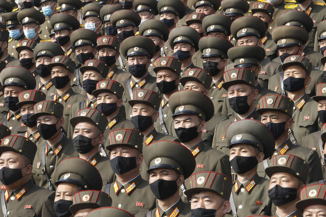 Soldiers wearing face masks to help curb the spread of the coronavirus rally to welcome the 8th Congress of the Workers' Party of Korea at Kim Il Sung Square in Pyongyang, North Korea, Monday, October 12, 2020. (Photo by Jon Chol Jin/AP Photo)