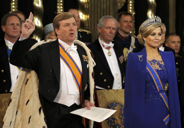 Dutch King Willem-Alexander takes the oath next to his wife Queen Maxima during a religious ceremony at the Nieuwe Kerk church in Amsterdam April 30, 2013. The Netherlands is celebrating Queen's Day on Tuesday, which also marks the abdication of Queen Beatrix and the investiture of her eldest son Willem-Alexander. (Photo by Peter Dejong/Reuters)