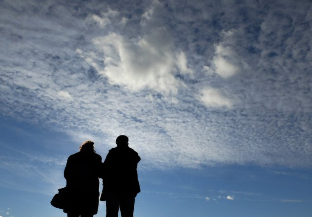 A couple looks at the Mediterranean Sea while on a walk on a sunny day in Valras-Plage, southern France January 4, 2015. (Photo by Yves Herman/Reuters)