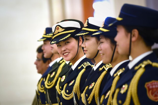 Chinese honour guards prepare for the arrival of Ecuador's President Rafael Correa and Chinese President Xi Jinping during a welcoming ceremony at the Great Hall of the People in Beijing on January 7, 2015. Correa is on a visit to China from January 5 to 9. (Photo by Wang Zhao/AFP Photo)