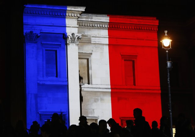 The colours of the French national flag are projected in tribute to the victims of the Paris terror attacks, onto The National Gallery in London January 11, 2015. (Photo by Eddie Keogh/Reuters)