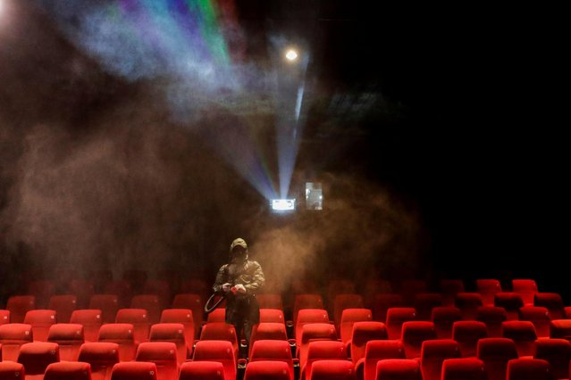 A man disinfects a hall at QFX Cinemas as they prepare to reopen from December 25 after nine months of closure, amidst the outbreak of the coronavirus disease (COVID-19), in Kathmandu, Nepal on December 23, 2020. (Photo by Navesh Chitrakar/Reuters)
