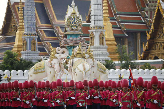 Thai Royal Guards march in front of the Grand Palace during a military parade as a part of a celebration for the upcoming birthday of King Bhumibol Adulyadej in Bangkok, Thailand December 3, 2015. The revered King, the world's longest reigning monarch, will turn 88 on December 5. (Photo by Jorge Silva/Reuters)