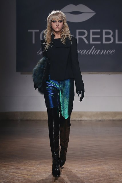 A model walks the runway during the Tom Rebl show as a part Milan Menswear Fashion Week Fall Winter 2015/2016 on January 19, 2015 in Milan, Italy. (Photo by Victor Boyko/Getty Images)