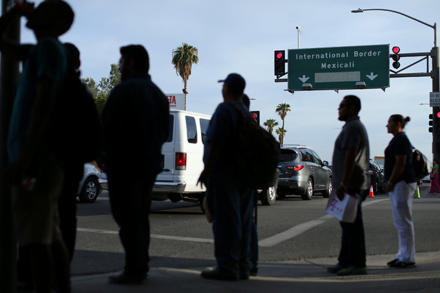 Pedestrians wait to cross the street in Calexico, California, Unites States, October 7, 2016. (Photo by Mike Blake/Reuters)