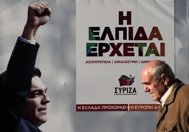 A man walks past a banner with an image of opposition leader and head of radical leftist Syriza party Alexis Tsipras at the party's pre-election kiosk in Athens in this January 15, 2015 file photo. (Photo by Alkis Konstantinidis/Reuters)