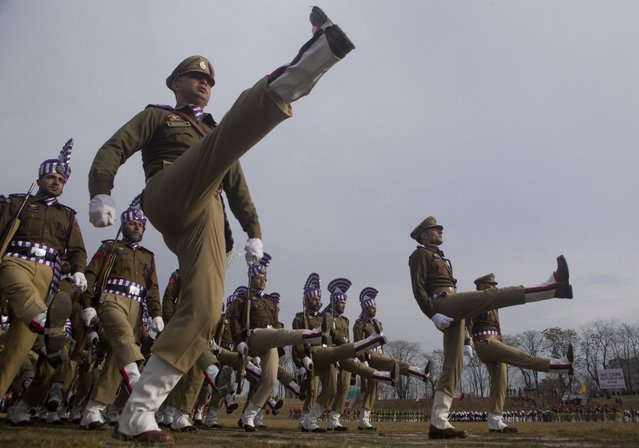 Indian police men march during a full dress rehearsal of the Republic Day parade in Srinagar, India, Saturday, January 24, 2015. (Photo by Dar Yasin/AP Photo)