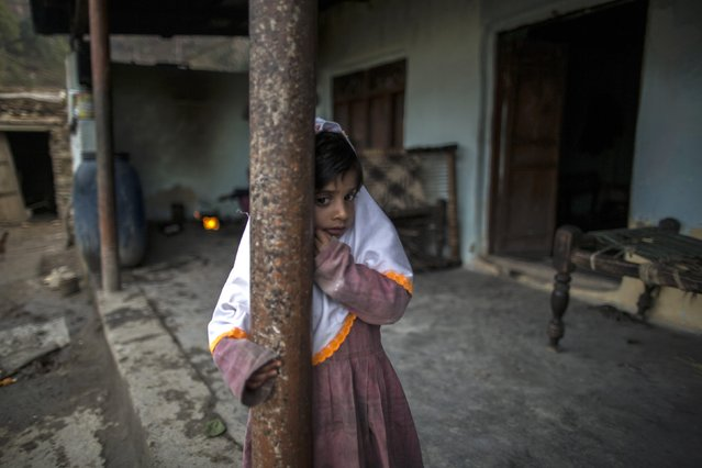 A girl stands at her house on Margalla Hills in Islamabad January 22, 2015. (Photo by Zohra Bensemra/Reuters)