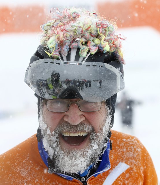 The beard of a skater, one out of some 1,100 athletes, is covered with ice and snow during the 200 km (124 miles) speed skating race in the Carinthian village of Techendorf January 30, 2015. (Photo by Leonhard Foeger/Reuters)
