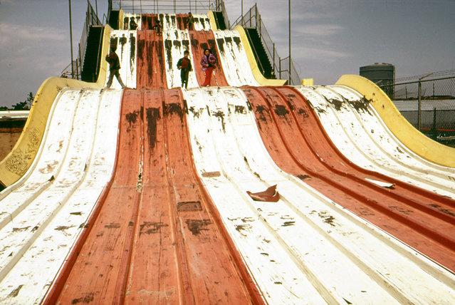 "Abandoned ""Giant Slide"" at Coney Island, in May of 1973. (Photo by Arthur Tress/NARA via The Atlantic)"