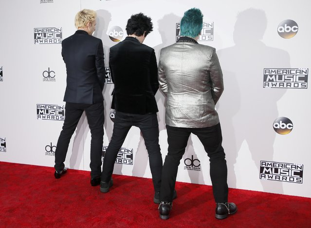 (L-R) Musicians Mike Dirnt, Billie Joe Armstrong and Tre Cool of Green Day arrive at the 2016 American Music Awards in Los Angeles, California, U.S., November 20, 2016. (Photo by Danny Moloshok/Reuters)