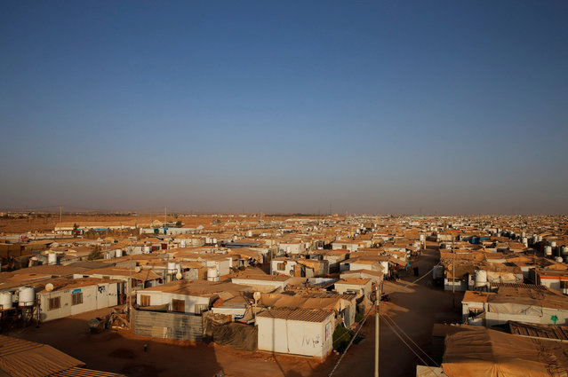 A general view shows Al-Zaatari Syrian refugee camp near the border with Syria, in Mafraq, Jordan  October 9, 2016. Mohammad Othman's bicycle route through the marketplace in the Syrian refugee camp of Zaatari was once a struggle against a tide of people. Now it's an easy ride. So many residents have left for the West, or been forced back to Syria by Jordanian authorities, that Zaatari, once the fastest-growing refugee camp in the Middle East, has gone quiet. Where there had been empty desert, a sprawling slum city emerged, with a population of 125,000 at its peak. Around half a million people have passed through.Shops sprang up offering everything from ice cream to pizzas, mobile phones or wedding gown rentals. Prime spots changed hands for thousands of dollars. (Photo by Ammar Awad/Reuters)