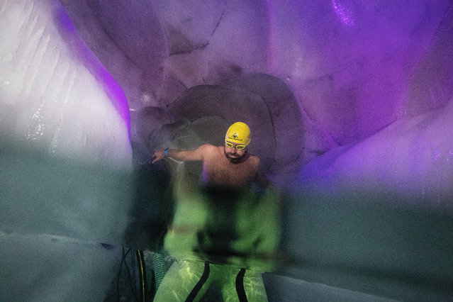 Ice swimmer Josef Koeberl prepares to swim in a filled up water kettle in an ice cave inside the Nature Ice Palace, with a hight of 3,250 meters (10,663 feet) above sea level, at Hintertux Glacier near Hintertux, some 480 kilometers (298 miles) western of Vienna, Austria, 28 July 2018. (Photo by Christian Bruna/EPA/EFE)