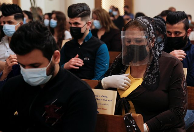 Worshippers attend a Palm Sunday mass, amid the coronavirus disease (COVID-19) outbreak, in a church in Baghdad, Iraq, March 28, 2021. (Photo by Teba Sadiq/Reuters)