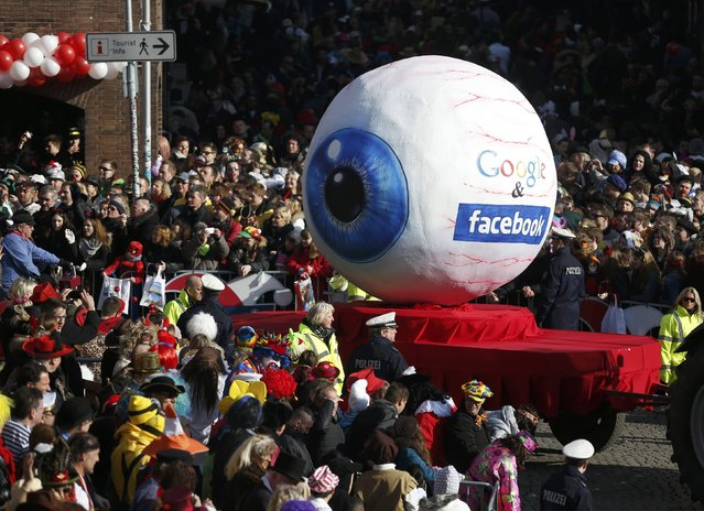 A carnival float with a papier-mache caricature representing Google and Facebook takes part in the traditional Rose Monday carnival parade in the western German city of Duesseldorf February 16, 2015. (Photo by Ina Fassbender/Reuters)