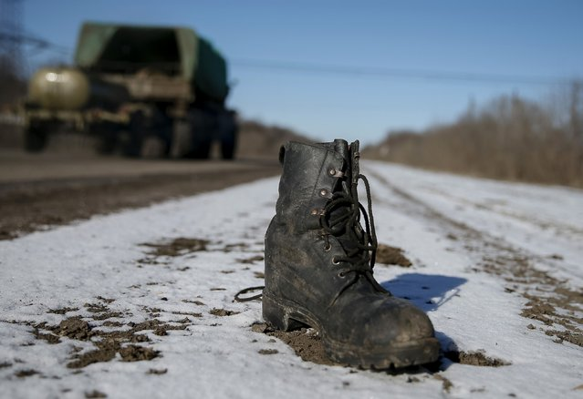 A military boot is seen at the road near Debaltseve, eastern Ukraine, February 17, 2015. (Photo by Gleb Garanich/Reuters)
