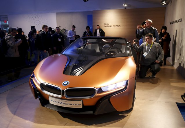 People look over the BMW i Vision Future Interaction concept car during the 2016 CES trade show in Las Vegas, Nevada January 7, 2016. The car includes BMW AirTouch technology that lets the driver control various functions with simple gestures. (Photo by Steve Marcus/Reuters)