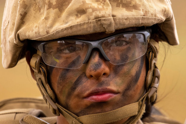 A recruit from U.S. Marine Corps Recruit Depot San Diego, Lima Company, listens to instructions as her platoon participates in the grueling crucible training to become the first ever women Marines trained at Camp Pendleton, California, U.S., April 21, 2021. (Photo by Mike Blake/Reuters)