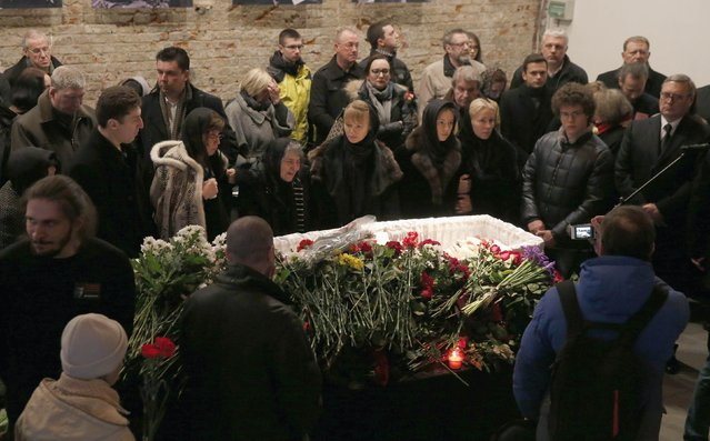 Mourners, including Dina Eidman (3rd L, front), mother of Russian leading opposition figure Boris Nemtsov, attend a memorial service before the funeral of Boris Nemtsov in Moscow, March 3, 2015. Several hundred Russians, many carrying red carnations, queued on Tuesday to pay their respects to Nemtsov, the Kremlin critic whose murder last week showed the hazards of speaking out against Russian President Vladimir Putin. REUTERS/Maxim Zmeyev