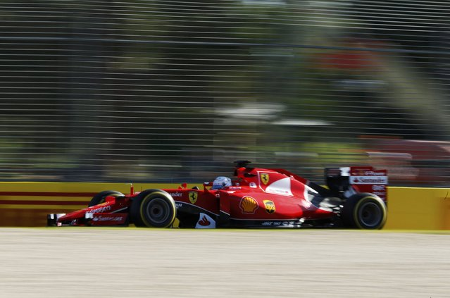 Ferrari Formula One driver Sebastian Vettel of Germany drives during the second practice session of the Australian F1 Grand Prix at the Albert Park circuit in Melbourne March 13, 2015. REUTERS/Jason Reed