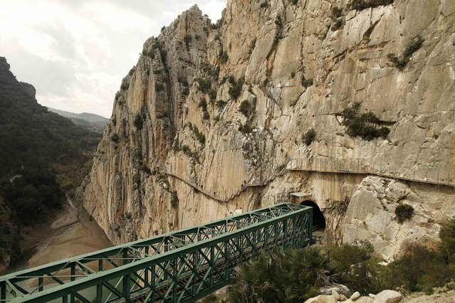 Journalists (C) walk along the new Caminito del Rey (The King's Little Pathway) in El Chorro-Alora, near Malaga, southern Spain March 15, 2015. (Photo by Jon Nazca/Reuters)