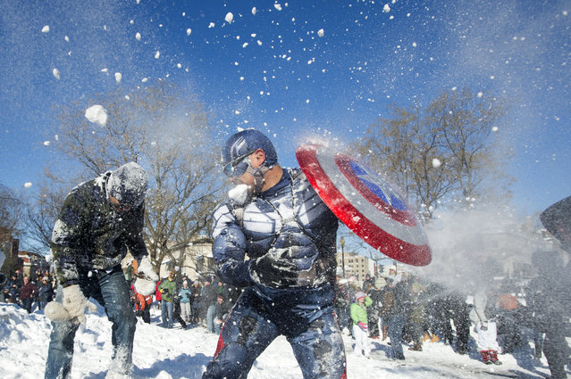Jeff Dacanay (C), while dressed as Captain America, is pelted with snow during a snowball fight following a blizzard, at Dupont Circle in Washington, D.C., Sunday, January 24, 2016. (Photo by Michael Reynolds/EPA)