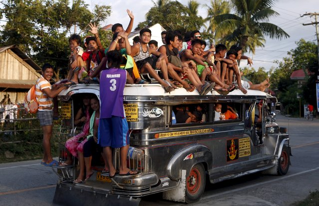 "Residents ride on top of an overcrowded ""Jeepney"", a locally manufactured public transport, along a highway in Mogpog town on Marinduque island in central Philippines in this April 8, 2015 file photo. The Philippines is expected to release GDP data this week. (Photo by Erik De Castro/Reuters)"