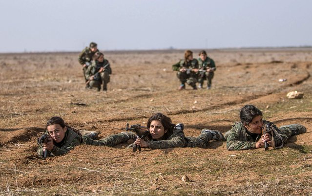 Female fighters of the Kurdish People's Protection Units (YPG) participate in military training in the western countryside of Ras al-Ain January 25, 2015. (Photo by Rodi Said/Reuters)